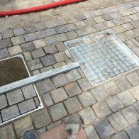 How do I cover a manhole cover?