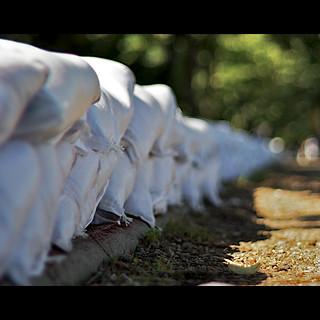 How do sandbags prevent flooding?