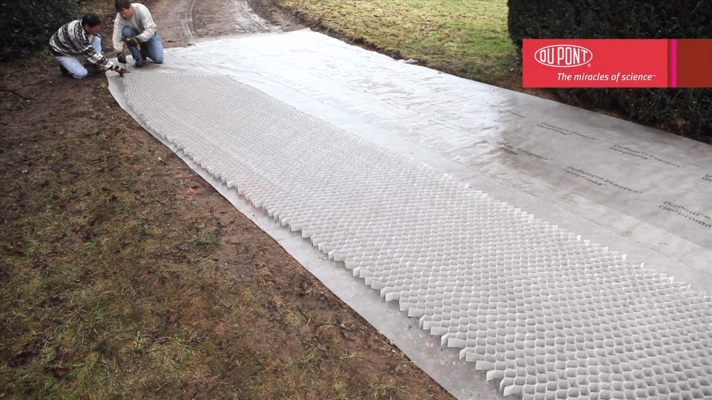 Step 3: Lay down and pin the gravel grid